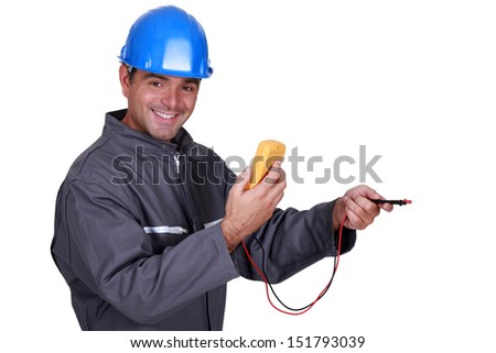 electrician holding a measurement tool and smiling - stock photo