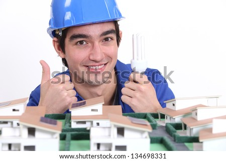 Electrician holding bulb - stock photo