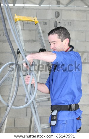 Electrician in a room under construction