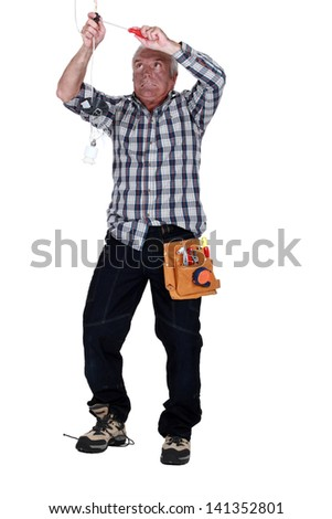 Electrician in trouble - stock photo