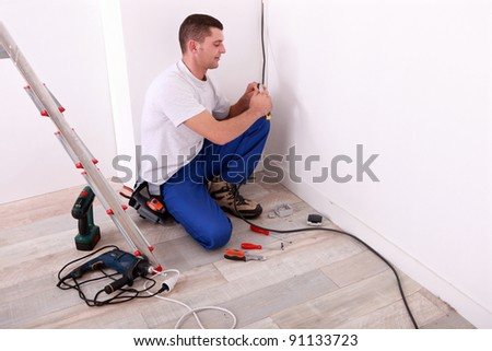 electrician installing cables - stock photo