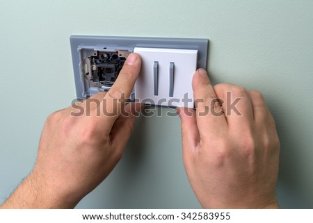 electrician installing the electricity system - stock photo