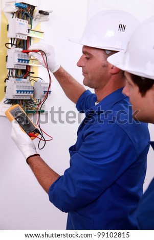 electrician measuring current - stock photo