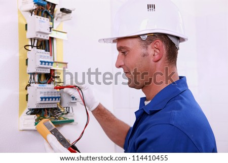 electrician measuring voltage - stock photo