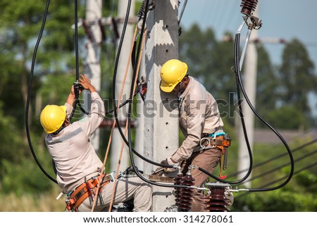 electrician overalls working at height and dangerous - stock photo