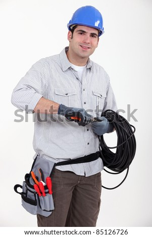Electrician preparing cable - stock photo