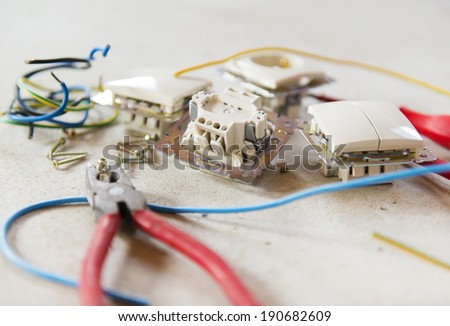 Electrician's tools for repairing the socket and swtich - stock photo