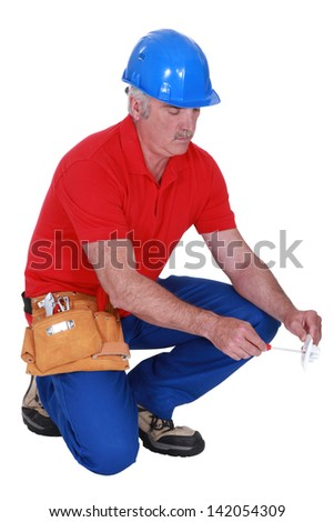 Electrician screwing a socket - stock photo
