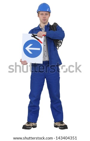 Electrician stood with coil and traffic sign - stock photo
