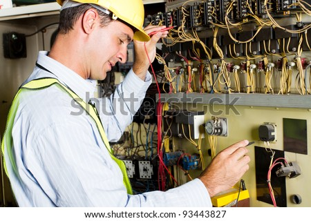 electrician testing industrial machine