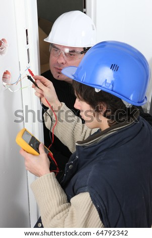 Electrician training an apprentice