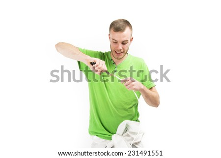 Electrician wearing a bright green t-shirt - white male with shaved head - stock photo