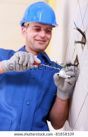 Electrician wiring a continental wall socket