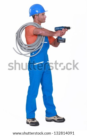 Electrician with a drill - stock photo