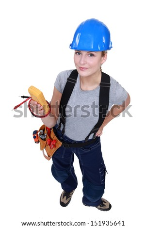 Electrician with a voltmeter. - stock photo