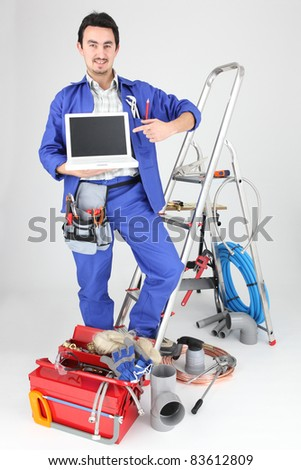 Electrician with computer and equipment - stock photo