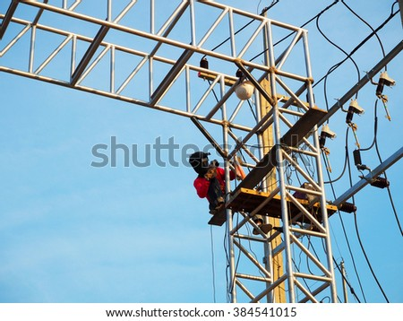 Electrician worker on the job at height - stock photo