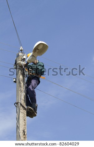 Electrician  worker  repair   lamps - stock photo