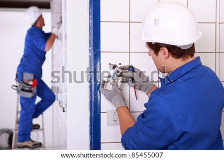Electricians at work - stock photo