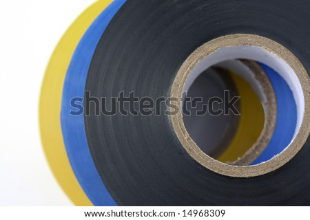 Electricians electrical insulation tape, yellow,black and blue isolated on a white background