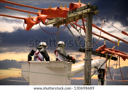 Electricians on a crane. - stock photo