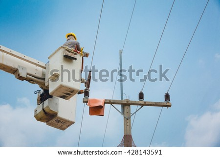 electricians repairing wire of the power line on electric power pole,22kv. - stock photo