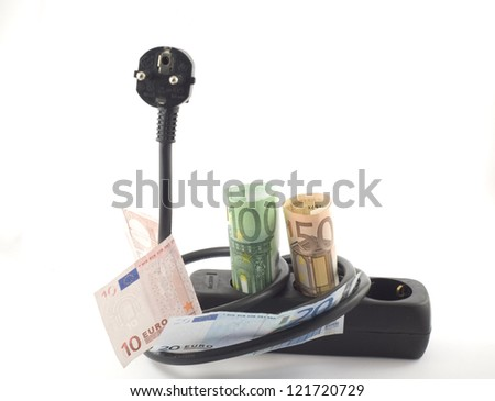 Electricity cable, plug and socket covered with banknotes. - stock photo