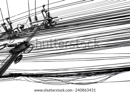 Electricity concrete Post Tangled Wires - stock photo