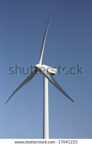 Electricity generating windmill against a clear blue sky