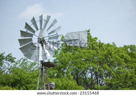 Electricity generator against sky. Ecological issue. Green Movement - stock photo