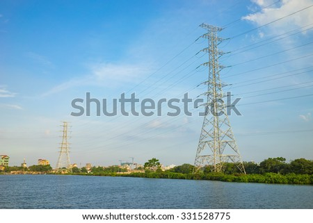 Electricity high voltage pole with Asian countryside view in clear day