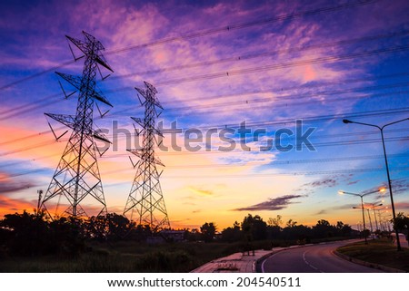 electricity high voltage power pylon at dusk - stock photo