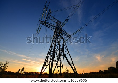 electricity line towers against sky - stock photo