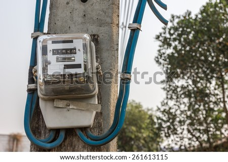 electricity meter connect with power line, on electricity pole - stock photo