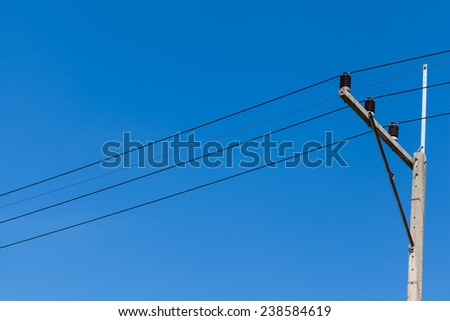 electricity pole with blue sky