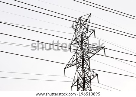 Electricity pole with numerous cables running through it.
