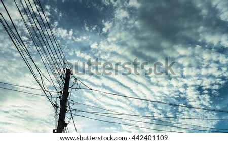 Electricity post blue sky background and cloud - stock photo