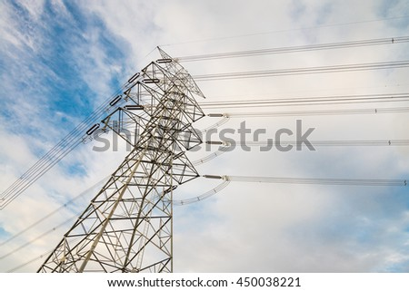 Electricity post high power with blue sky background at low angle view in evening
