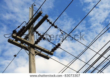 electricity post in blue sky - stock photo