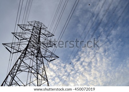 electricity post on blue sky background,low angle view.