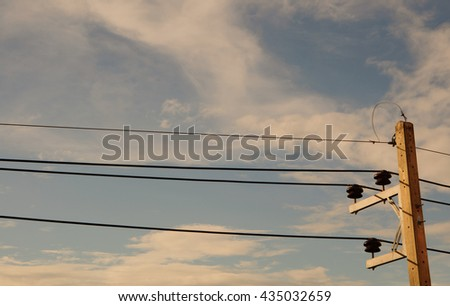 electricity post with cloudy and blue sky. warm color. filter effect. - stock photo
