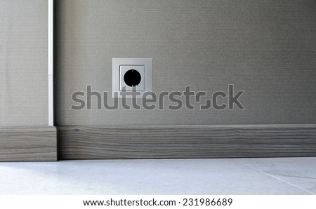 Electricity power socket (European standard) on wall background  - stock photo