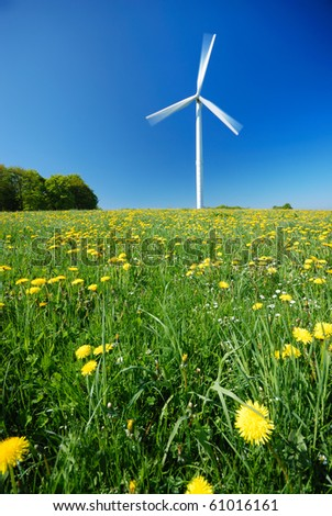 Electricity power wind generator pole against blue sky background