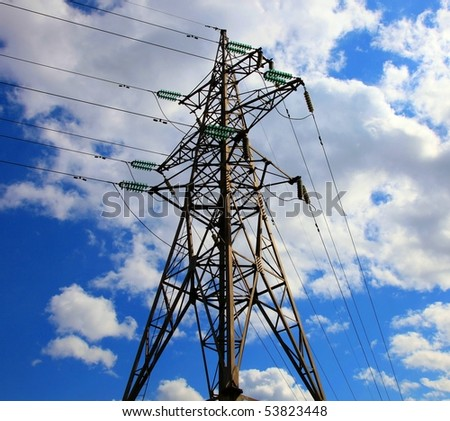 Electricity pylon against cloudy sky