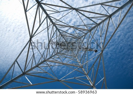 Electricity pylon as seen from right under - stock photo