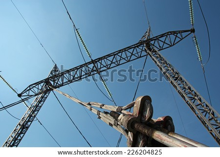 Electricity Pylon. Electricity Distribution.  High Voltage AC Transmission Towers. - stock photo