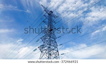 Electricity Pylon, high tension voltage transmission tower. - stock photo