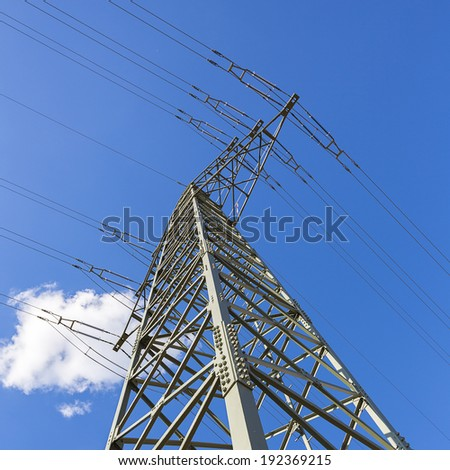 Electricity pylon on blue sky with clouds electricity overhead line solar energy
