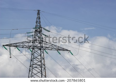 Electricity pylon supporting wires for electrical power distribution. Utility pole with lot of wires.