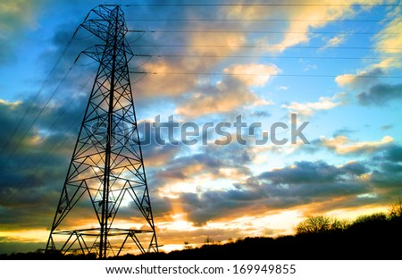 Electricity Pylon - UK standard overhead power line transmission tower - stock photo